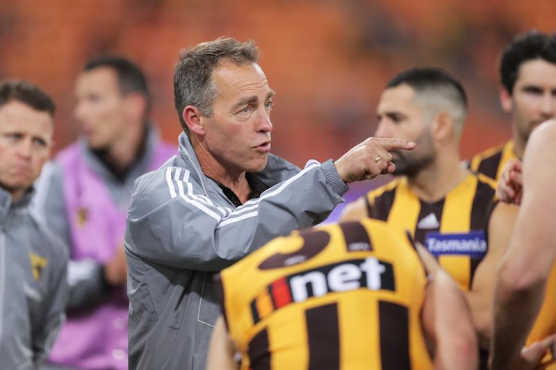 Hawks head coach Alastair Clarkson speaks to players at three quarter time during the round 5 AFL match.