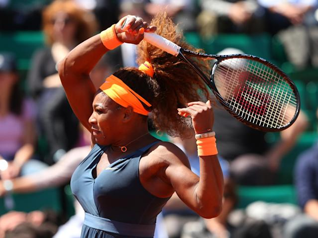 PARIS, FRANCE - JUNE 04: Serena Williams of United States of America plays a forehand during her Women's Singles Quarter-Final match against Svetlana Kuznetsova of Russia on day ten of the French Open at Roland Garros on June 4, 2013 in Paris, France. (Photo by Julian Finney/Getty Images)