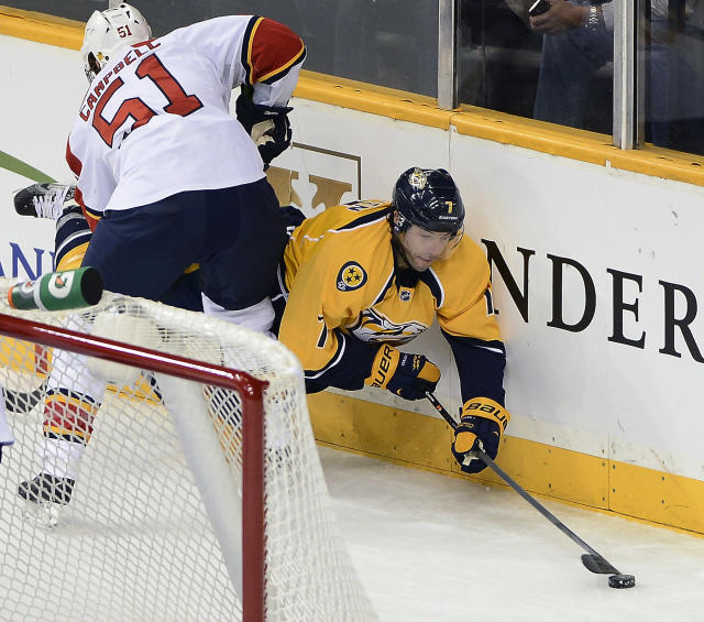 Nashville Predators forward Matt Cullen, right, is checked into the boards by Florida Panthers defenseman Brian Campbell while taking the puck behind the net in the first period of an NHL hockey game on Tuesday, Oct. 15, 2013, in Nashville, Tenn. (AP Photo/Mark Zaleski)
