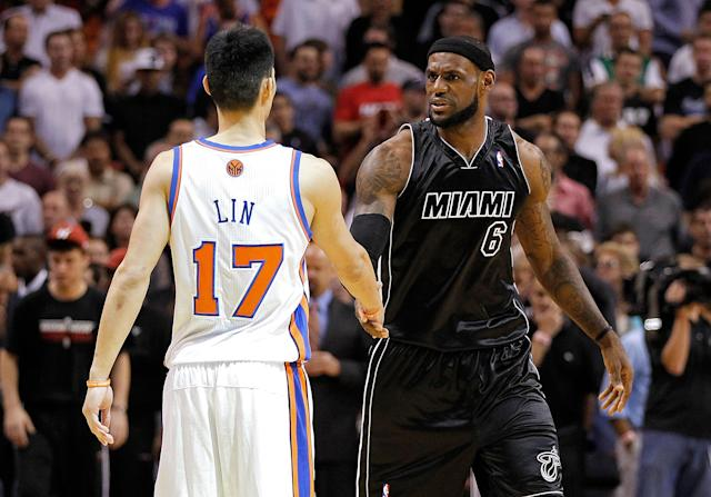 MIAMI, FL - FEBRUARY 23: Jeremy Lin #17 of the New York Knicks greets LeBron James #6 of the Miami Heat during a game at American Airlines Arena on February 23, 2012 in Miami, Florida. NOTE TO USER: User expressly acknowledges and agrees that, by downloading and/or using this Photograph, User is consenting to the terms and conditions of the Getty Images License Agreement. (Photo by Mike Ehrmann/Getty Images)