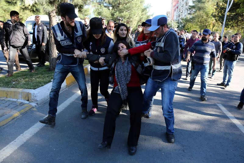 FILE PHOTO: Police detain DBP co-chair Tuncel during a protest against the arrest of Kurdish lawmakers, in Diyarbakir