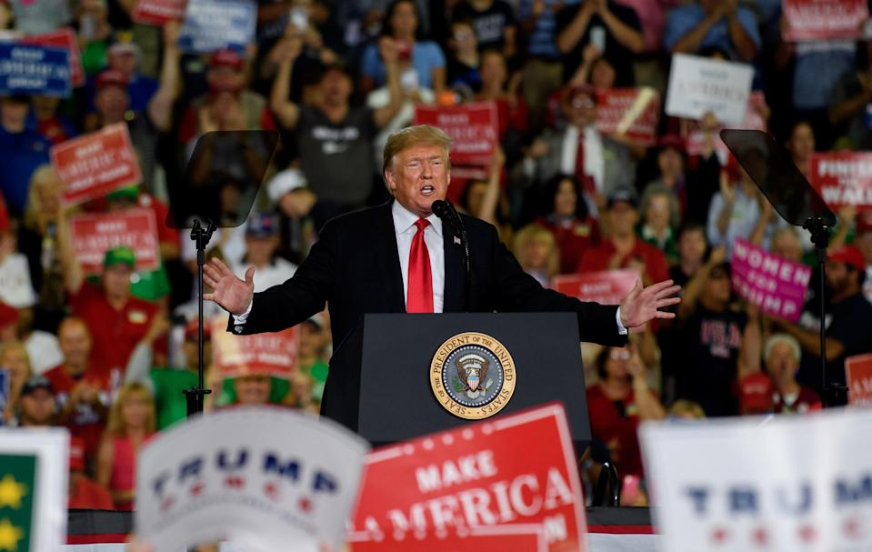 President Trump speaks to supporters at a rally. (Photo: Getty Images)