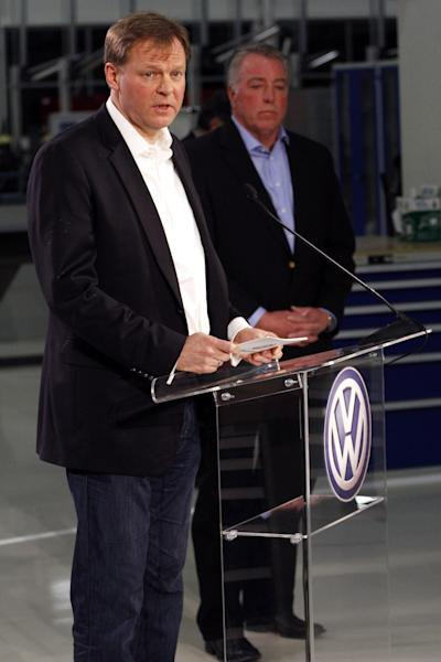 Frank Fischer, Chairman and CEO of the Volkswagen Group of America, left, speaks on behalf of the company after it was announced that Volkswagen employees voted to deny representation by the United Auto Workers union, as Gary Casteel, UAW Region 8 Director, looks on from behind, concluding a three day election which ended this evening Friday, Feb. 14, 2014, in Chattanooga, Tenn. (AP Photo/Chattanooga Times Free Press, Dan Henry) THE DAILY CITIZEN OUT; NOOGA.COM OUT; CLEVELAND DAILY BANNER OUT; LOCAL INTERNET OUT