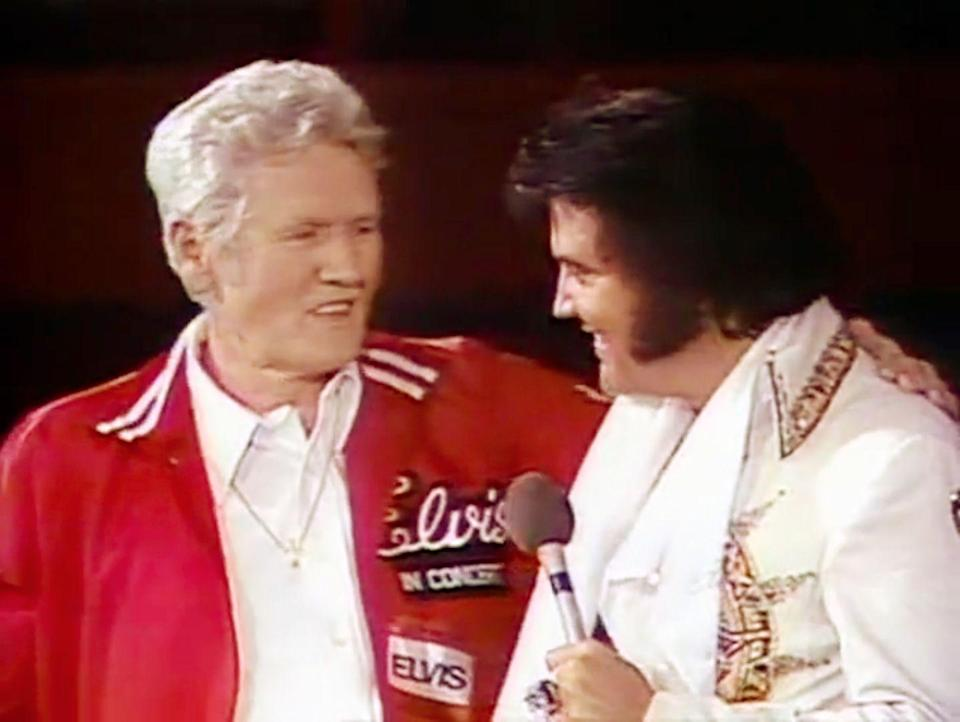 """<p><a href=""""https://www.goodhousekeeping.com/life/entertainment/news/a46682/elvis-and-lisa-marie-presley-singing-daddy-dont-cry/"""" rel=""""nofollow noopener"""" target=""""_blank"""" data-ylk=""""slk:The King"""" class=""""link rapid-noclick-resp"""">The King</a> celebrated his final Father's Day with his biggest fan, his father Vernon Presley. Elvis brought his father on stage during his performance in Omaha, Nebraska, which was filmed for <em><a href=""""https://www.amazon.com/Elvis-Concert-Presley/dp/B000002WEV?tag=syn-yahoo-20&ascsubtag=%5Bartid%7C10055.g.21205120%5Bsrc%7Cyahoo-us"""" rel=""""nofollow noopener"""" target=""""_blank"""" data-ylk=""""slk:Elvis in Concert"""" class=""""link rapid-noclick-resp"""">Elvis in Concert</a>,</em> a concert movie that was released later that year. </p>"""