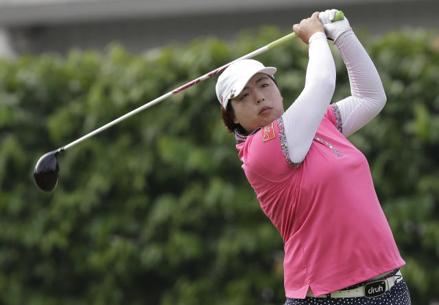 China's Shanshan Feng watches her tee shot during her second at the Malaysian LGPA event in Kuala Lumpur, Friday, Oct. 11, 2013. (AP Photo/Mark Baker)