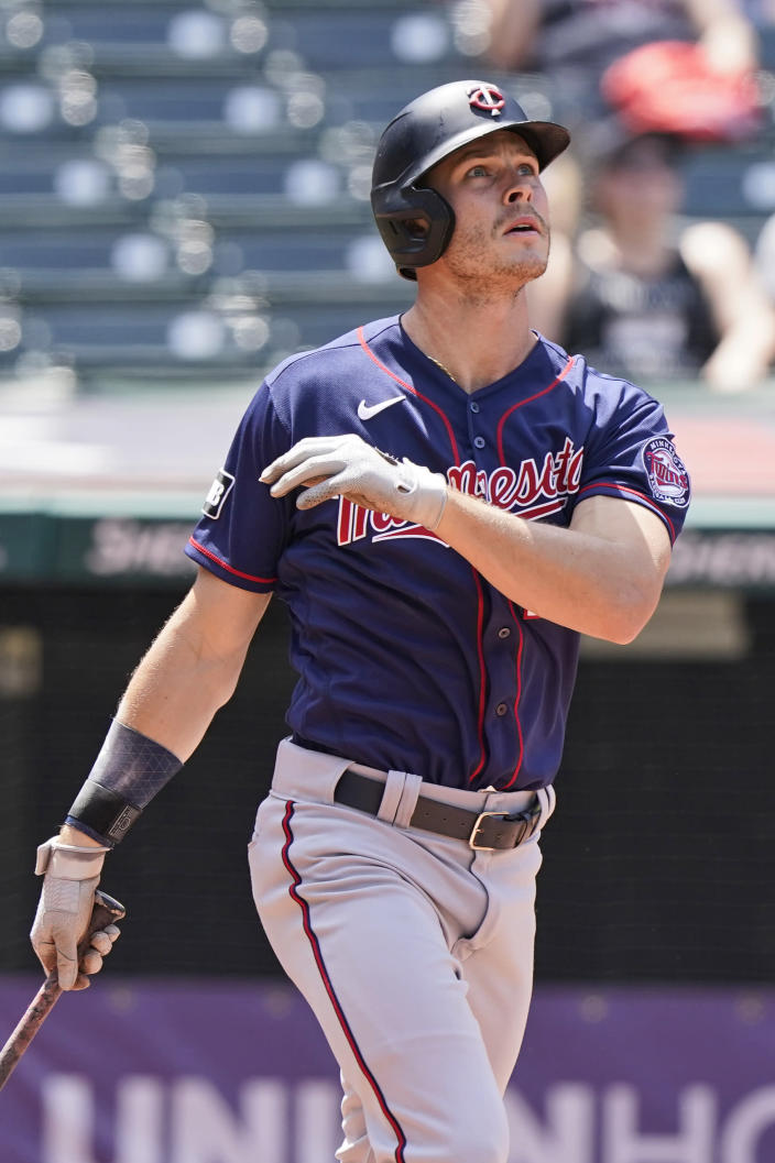 Minnesota Twins' Max Kepler watches his three-run home run in the fourth inning of a baseball game against the Cleveland Indians, Sunday, May 23, 2021, in Cleveland. (AP Photo/Tony Dejak)
