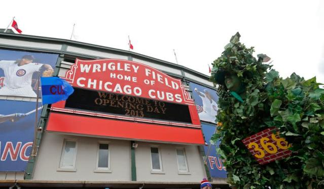 A fan dressed up as the Wrigley Field Center Field is seen outside the stadium prior to the Chicago Cubs' MLB National League baseball game home opener against the Milwaukee Brewers in Chicago