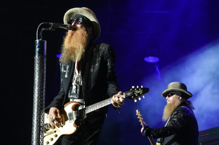 Dusty Hill (R) and Billy Gibbons (L) of ZZ Top perform in France in 2016