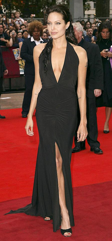 """The appearance made by Angelina Jolie's leg at the 2012 Oscars telecast was one of the most popular things about the entire show! Of course, that wasn't the first time the actress had flaunted her gams. Back in 2003, the """"Girl, Interrupted"""" star strutted her stuff in a black dress -- obviously one of her favorite shades to wear -- with a plunging neckline and, yep, a sexy slit that allowed people to catch a glimpse of her right leg at the premiere of """"Lara Croft Tomb Raider: The Cradle Of Life"""" in London. (8/19/2003)"""