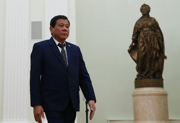 """Duterte warned martial law would be """"harsh"""" and similar to military rule imposed by dictator Ferdinand Marcos a generation ago. (AFP Photo/MAXIM SHEMETOV)"""
