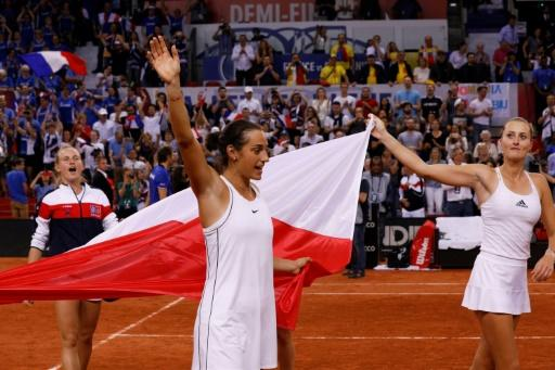 Team leaders: France's Kristina Mladenovic (right) and Caroline Garcia celebrate their Fed Cup semi-final win over Romania that put them into the final against Australia