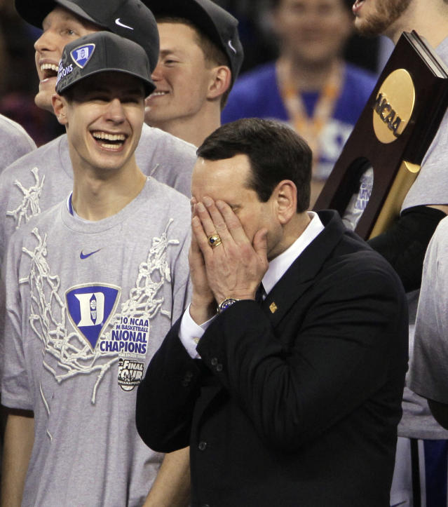 FILE - In this April 5, 2010, file photo, Duke head coach Mike Krzyzewski is overcome with emotion after Duke's 61-59 win over Butler in the men's NCAA Final Four college basketball championship game in Indianapolis. At left is Duke guard Jon Scheyer. (AP Photo/Amy Sancetta, Fle)