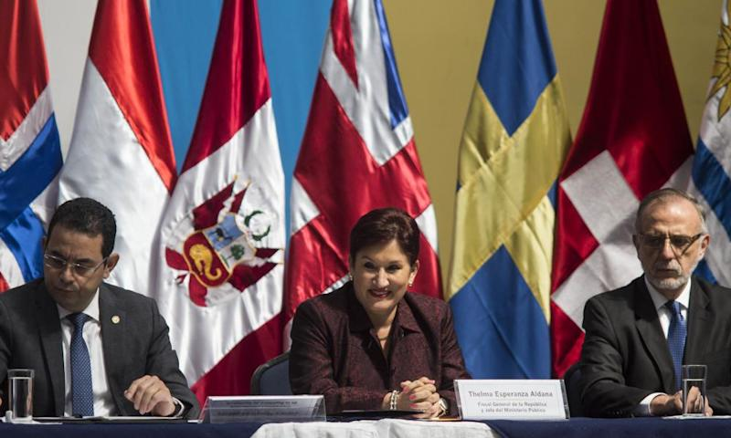 Guatemala's attorney general Thelma Aldana, is flanked by Iván Velásquez, commissioner of the Cicig, right, and the Guatemalan president, Jimmy Morales, in Guatemala City in 2016.