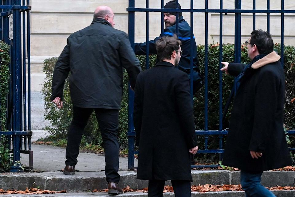 Willy Bardon (L), accused of kidnapping, confinement, rape and murder in the case of Elodie Kulik arrives with his lawyers: AFP via Getty Images
