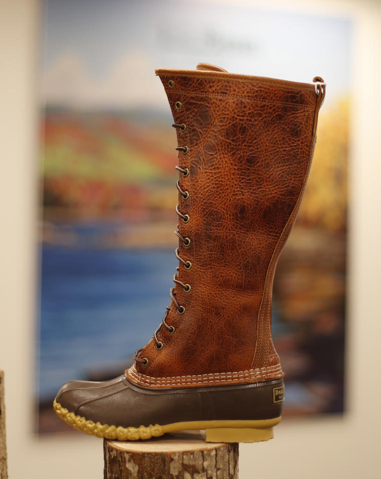 """A fashionable L.L. Bean boot is displayed at the company's new plant in Lewiston, Maine, Thursday, Aug. 17, 2017. The Maine-based retailer plans to expand production to keep up with demand for its leather-and-rubber """"duck boot"""" with a new manufacturing center being unveiled Thursday. The company hopes to make 750,000 pairs of boots this year, and to hit the 1 million mark in 2018. (AP Photo/Robert F. Bukaty)"""