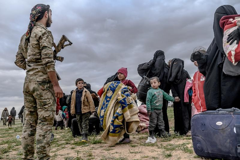 """Kurdish-led forces slowed their assault on the final Islamic State group holdout in Syria to allow civilians to leave the crumbling """"caliphate"""" (AFP Photo/Bulent KILIC)"""