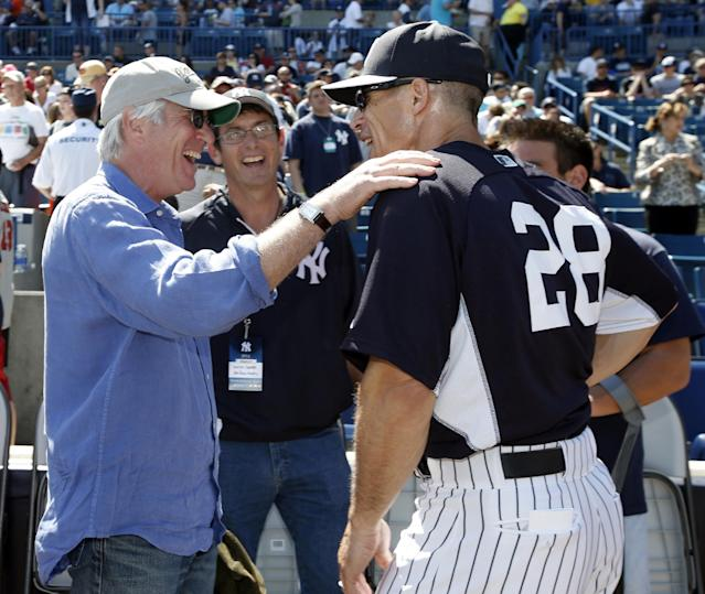 Actor and New York Yankees fan Richard Gere, left, talks with Yankees manager Joe Girardi (28) before throwing out the ceremonial first pitch at a spring training baseball game against the Tampa Bay Rays in Tampa, Fla., Sunday, March 9, 2014. (AP Photo/Kathy Willens)