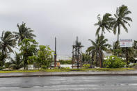 The sky is clouded over in the distance as intermittent rain and wind continue at Suva Harbour in Suva, Fiji, Friday, Dec. 18, 2020. Dozens of homes have been destroyed by a cyclone Yasa which hit the island nation overnight.(AP Photo/Aileen Torres-Bennett)