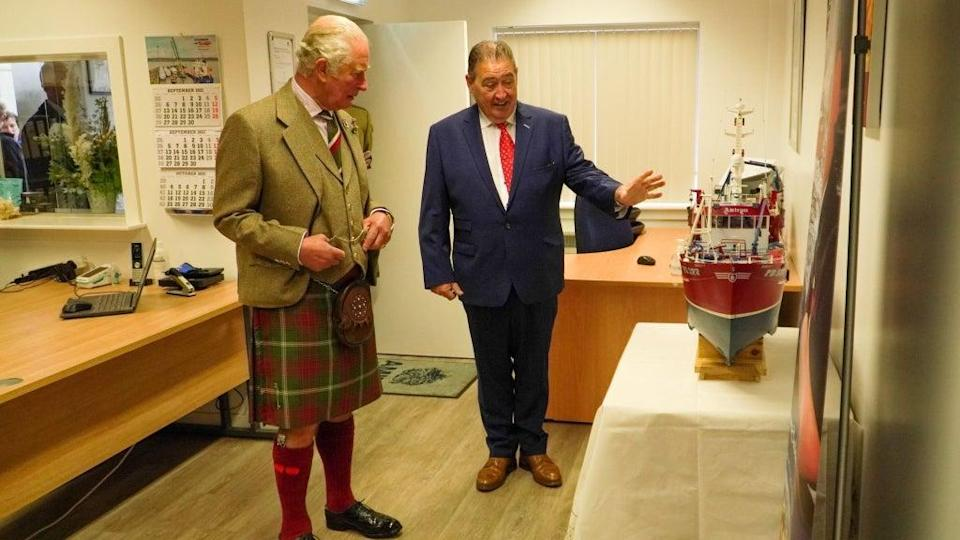 Charles during a visit to Amity Fish Company in Peterhead (PA Media)