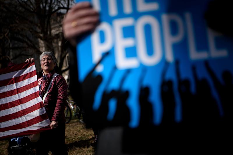 People gather to protest US President Donald Trump during Presidents' Day in Lafayette Square near the White House on Feb. 18, 2019 in Washington, D.C. (Photo: Brendan Smialowski/AFP/Getty Images)