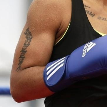 "A tattoo that reads ""Queen"" is seen on the right arm of United States' 60-kg lightweight boxer Queen Underwood during a practice session at the 2012 Summer Olympics, Thursday, July 26, 2012, in London. (AP Photo/Patrick Semansky)"