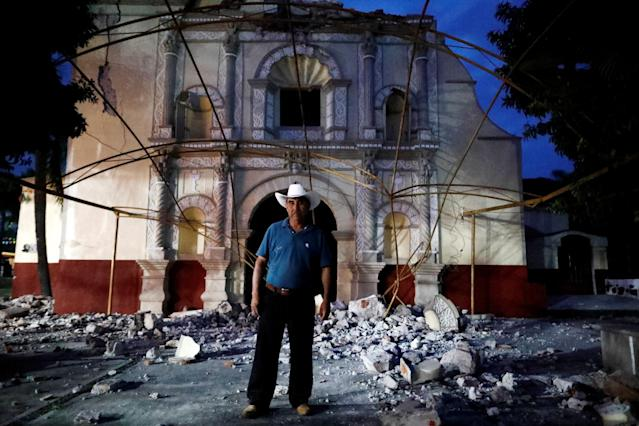 "<p>Juan Sanchez, 53, a parishioner and a church guard, poses for a portrait in front San Juan Bautista church after an earthquake in San Juan Pilcaya, at the epicentre zone, Mexico, September 28, 2017. His house wasn't damaged so he has offered shelter to some families in his backyard. ""We are holding mass under a tent. It is a great sadness, we are waiting for the government's help to rebuild our church,"" Sanchez said. (Photo: Edgard Garrido/Reuters) </p>"