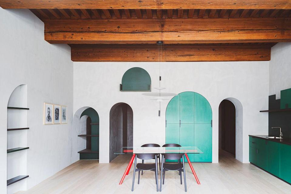 """<p><a href=""""https://studiorazavi.com/"""" rel=""""nofollow noopener"""" target=""""_blank"""" data-ylk=""""slk:Studio Razavi"""" class=""""link rapid-noclick-resp"""">Studio Razavi</a> ushered this old country home in Lyon, France, into the modern era with bold, saturated colors and fresh, architectural designs. The firm chose to preserve the existing bones of the space, like the exposed beams and arches while also giving it their signature forward-thinking treatment. Modern eclectic design at its finest. </p>"""