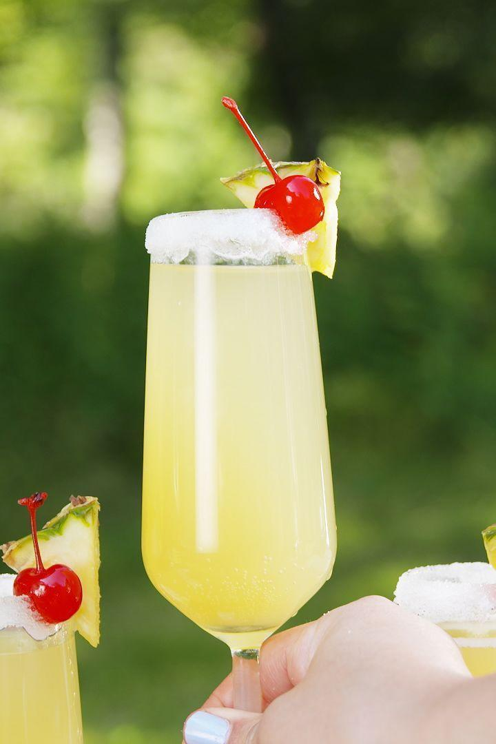 "<p>This is the perfect drink to sip beachside (or poolside) this summer. And how about a snack? These <a href=""https://www.delish.com/uk/cooking/recipes/a31257052/fried-pina-colada-rings-recipe/"" rel=""nofollow noopener"" target=""_blank"" data-ylk=""slk:Fried Pina Colada Rings"" class=""link rapid-noclick-resp"">Fried Pina Colada Rings</a> are insanely delicious😍</p><p>Get the <a href=""https://www.delish.com/uk/cocktails-drinks/a32386187/pina-colada-mimosas-recipe/"" rel=""nofollow noopener"" target=""_blank"" data-ylk=""slk:Piña Colada Mimosas"" class=""link rapid-noclick-resp"">Piña Colada Mimosas</a> recipe.</p>"