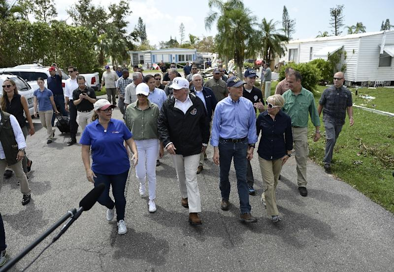 President Donald Trump tours a flood-damaged neighborhood in Naples, Florida (AFP Photo/Brendan Smialowski)