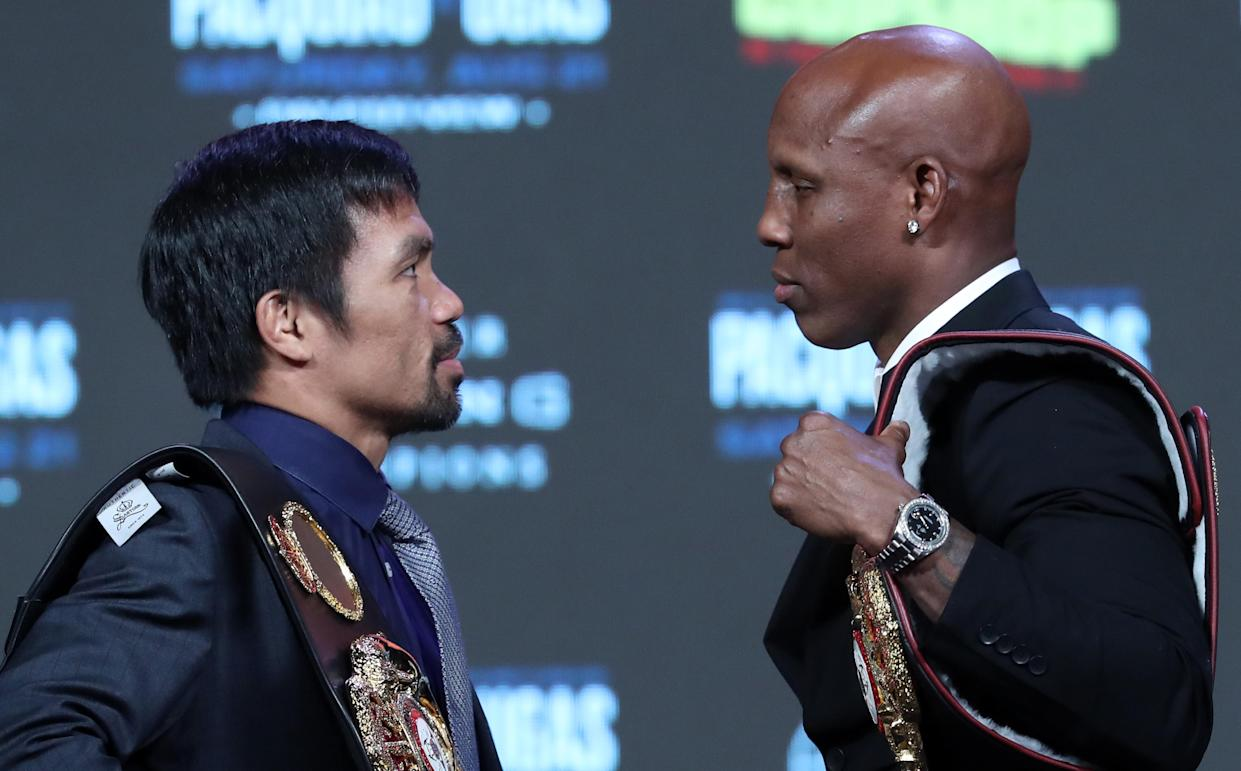 LAS VEGAS, NEVADA - AUGUST 18: Manny Pacquiao (L) and WBA welterweight champion Yordenis Ugas face off during a news conference at MGM Grand Garden Arena on August 18, 2021 in Las Vegas, Nevada. Pacquiao will challenge Ugas for his title at T-Mobile Arena on August 21 in Las Vegas. (Photo by Steve Marcus/Getty Images)