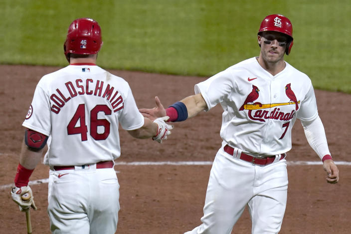 St. Louis Cardinals' Andrew Knizner is congratulated by teammate Paul Goldschmidt (46) after scoring during the fifth inning of a baseball game against the Colorado Rockies Friday, May 7, 2021, in St. Louis. (AP Photo/Jeff Roberson)