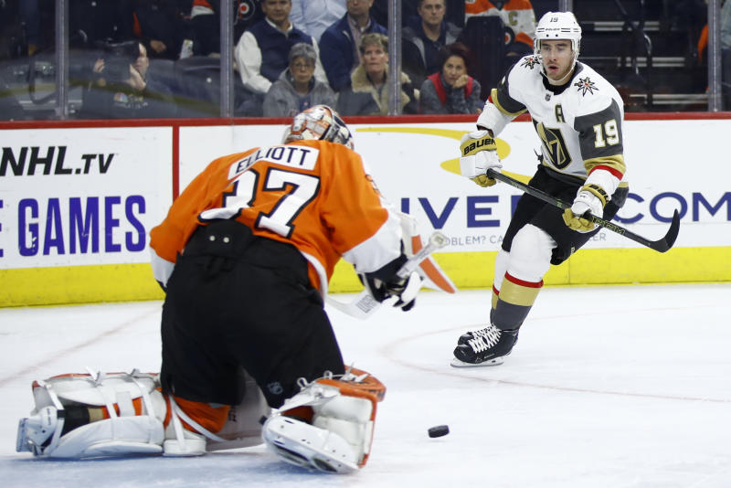 Philadelphia Flyers' Brian Elliott blocks a shot by Vegas Golden Knights' Reilly Smith during the first period of an NHL hockey game Monday, Oct. 21, 2019, in Philadelphia. (AP Photo/Matt Rourke)