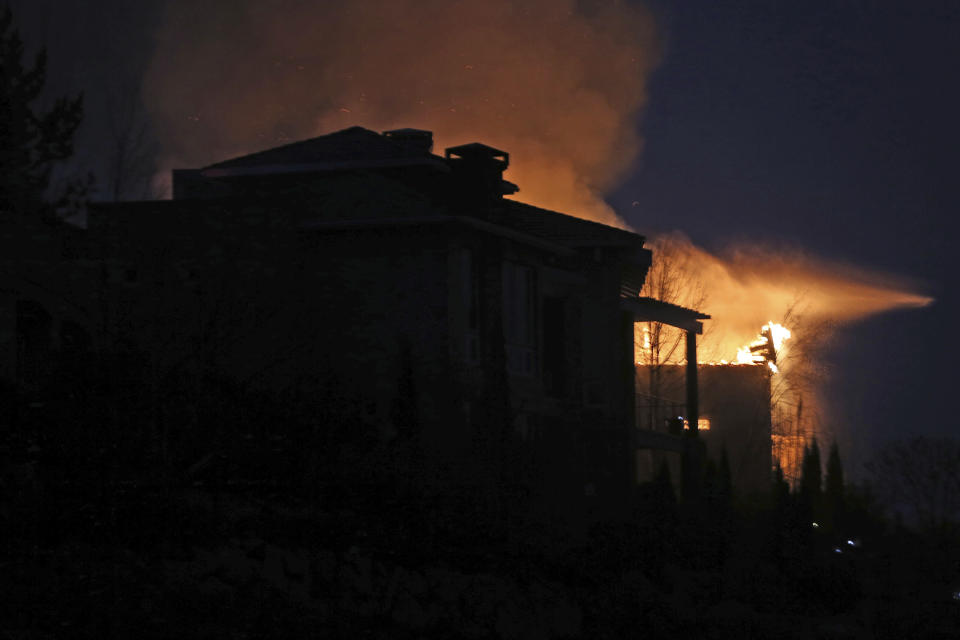 Wildfires in Southwest Reno, destroy a number of homes in the Juniper Hills area of Reno, Nev., Tuesday, Nov.17, 2020. (AP Photo/Lance Iversen)