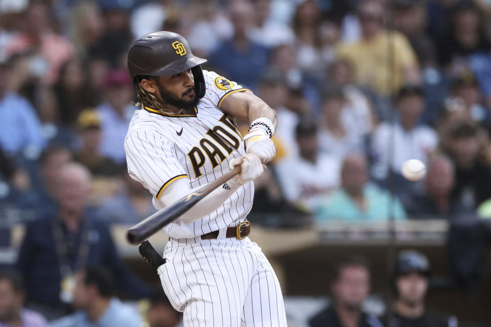 San Diego Padres shortstop Fernando Tatis Jr. hits an RBI double against the Colorado Rockies during the first inning of a baseball game Thursday, July 29, 2021, in San Diego. (AP Photo/Derrick Tuskan)