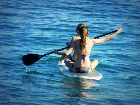 Renting paddle-boards is one of the many adventurous ways to enjoy Catalina Island without harming the environment. Photo by Allison Jervis.