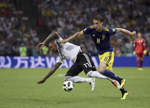 Sweden's Albin Ekdal, right, duels for the ball with Germany's Jerome Boateng during the group F match between Germany and Sweden at the 2018 soccer World Cup in the Fisht Stadium in Sochi, Russia, Saturday, June 23, 2018. (AP Photo/Thanassis Stavrakis)
