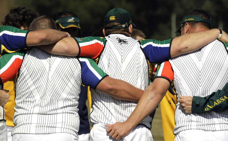 South Africa captain John Smit, center,  forms a human chain with teammates  after their training in Johannesburg, South Africa, Friday July 15, 2011. Smit leads an injury-hit, under-strength and inexperienced South Africa squad on his last Tri-Nations tour as the defending world champion begins its crucial run-in to the Rugby World Cup without 21 frontline players. (AP Photo/Themba Hadebe)