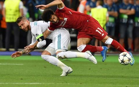 "Mohamed Salah in tears as Champions League final ends in early injury heartbreak By the end of the night it felt that whatever Gareth Bale tried in this Champions League final would find the back of the Liverpool net, and even if what he attempted was not good enough then it would be Loris Karius' misfortune to make it that way. An outrageous divergence of fortunes on European football's biggest night, when Bale came on and changed once again the trajectory of his career with a first goal that was good enough to win all three of the Champions League finals which Real Madrid have collected in the last three years. The Welshman rose from the bench on 61 minutes, scored twice and played the Cristiano Ronaldo role with Cristiano Ronaldo still on the pitch, thoroughly upstaged. Bale's first, an overhead kick two minutes after coming on was applauded by Zinedine Zidane in the knowledge that his swivel and volley goal in the 2002 final at Hampden Park has now been eclipsed as arguably the greatest goal ever scored on this stage. The second from Bale was a catastrophe for Karius, a swish of a boot from Bale from 40 yards out that was straight at the Liverpool goalkeeper's nose and yet one that he then slapped into his own goal. The first Madrid goal had been Karius's fault too, a ball thrown against Karim Benzema's outstretched foot that you would be disappointed to concede in the Monday night five-a-side. And then in the meantime there was Mohamed Salah, walking off in tears on 29 minutes after being thrown to the ground by Sergio Ramos. If it could do wrong then it did go wrong for Liverpool, and in the end the 13th European Cup for Madrid never truly looked in doubt. This was not Salah's night, and it was not Ronaldo's night, it was Bale's night, five years after he joined the club, collecting his fourth European Cup title and coming back from the shadows to take centre-stage. Gareth Bale makes an immediate impact with a stunning overhead kick from 18 yards Credit: REUTERS/Phil Noble The entanglement between Salah and Sergio Ramos was one of those moments that might have passed without mention until when you watched it again and again and the nature of the damage was obvious. The natural assumption was that Ramos meant it, that he knew that to trap Salah's right arm and twist him over so he fell in a precipitous headfirst downward motion – neck and shoulder crushed into the turf – was all planned. That is what Ramos is perceived to be, the great cynical win-at-all-costs merchant with a diabolical plan for every occasion. Yet, it is hard to say for sure that he wanted to inflict such obvious discomfort on Liverpool's star player that when Salah went down for the second time in agony from his left shoulder that he came up shedding tears. Sure, Ramos locked that right arm of Salah's for longer than might be supposed meaning that the Liverpool man could not break his fall, and he sent him down like a wrestler onto the mat headfirst. Whether he intended such damage is hard to say. Salah injures his shoulder when Ramos challenges him, holds on to his arm then pins him to the ground Credit: GENYA SAVILOV/AFP/Getty Images It was a grievous blow for Liverpool who had been blown around for periods of the first half, incapable of breaking the rhythms of Madrid's passing, and the Spanish side finished the half with 65 per cent of the possession. When Liverpool did break forward they were urgent and they did have the one attempt on target of the first half, a shot from Trent Alexander-Arnold that Keylor Navas saved easily. That was arguably their best moment of the first half on 23 minutes when Andy Robertson was released down the left after an exchange with Sadio Mane and his cross was first controlled and struck goalward by Roberto Firmino. When that was blocked it came to Alexander-Arnold, the first teenager to start a Champions League final since Johan Neeskens for Ajax in 1971. Salah's shoulder slam into the turf came just two minutes later and his departure threw his team-mates. They have become so used to the power he gives them over opposing sides that they struggled for confidence in the late stages of the first half and his replacement Adam Lallana, who had previously played 16 minutes since the end of March, needed time to adjust to the pace of the game. Bale tries to console a distraught Karius at the end Credit: PHIL NOBLE/REUTERS In the closing stages of the half Karim Benzema had the ball in the Liverpool goal after Loris Karius had elected to punch Cristiano Ronaldo's header but the latter had already been flagged offside. Generally Liverpool had looked confident in defence, led by Virgil Van Dijk in the centre while Dejan Lovren had almost put Ronaldo into the halfway line television camera within 30 seconds of the kick-off. But the pace of the first half was dictated by Madrid. There were times when they were sloppy with the ball, and Ronaldo switched from the left to the right too little effect in the first 45 minutes. Yet Madrid had so much of the ball that when it did finally fall into Liverpool's possession they were too eager move it quickly when they might just have granted themselves some time in control. Their best period before the break was the first ten minutes when Alexander-Arnold, Salah and Firmino combined at different times to open up the left side of Madrid's defence. Their passing was crisp and it felt they were tuning up for something more dangerous when Madrid gradually seized control. Madrid also lost a player to injury before the first half, and Dani Carvajal also departed in tears but if there was one they could afford to lose then it was their right-back. Sergio Ramos lifts Real Madrid's 13th European Cup Credit: David Ramos/Getty Images Isco hit the bar within three minutes of the start if the new half, the kind of chance that he should really have taken when Lallana failed to get the ball away and it dropped for the Madrid man in the area. That time Karius was stranded and could do nothing about the outcome although the Benzema goal was a different story. The German had the ball in his hands and Benzema, perhaps slightly more tenaciously than expected, dangled a foot in front of the goalkeeper's under-arm distribution and got the full force of it. It dribbled off Benzema's foot and into the corner of Liverpool's goal in a second when many might have looked away from the match. ���� #CHAMP13NS OF EUROPE!!! pic.twitter.com/NCo9HdYJoZ— Real Madrid C.F.�������� (@realmadriden) May 26, 2018 They looked up to see Karius protesting – protesting what? – and Jurgen Klopp, a man of so many emotions, unable to express a single one on the touchline. If anything, once the initial shock had subsided, it liberated Liverpool a little. From Milner's cross from the right they won the corner which Lovren won over the top of Ramos for Sadio Mane to squeeze in. Bale had come on after the hour for Isco, who had not taken his chances and within two minutes he had taken his opportunity. It is hard enough to execute an overhead kick in any circumstances and Bale did not have time to fully rotate and extend. But he caught Marcelo's cross at the perfect point of the arc and you knew instantly you had seen one of the goals of a lifetime. His second of the night was a disaster for Karius who slumped to the floor at the end of the game, and Bale was one of the first to try to pick him off the turf. 10:44PM A compassionate word of wisdom Feel sorry for Karius but it's how you bounce back I have been there it's a dark place to be I hope he comes through it Stay strong Believe in yourself Goalkeepers Union— Neville Southall (@NevilleSouthall) May 26, 2018 10:41PM Zidane speaks ""Great emotions, to live this. To win three Champions Leagues with this club, this team is magnificent. [Was Bale's goal better than yours at Hampden?] It was different but Gareth's goal was magnificent. We are going to enjoy what we've achieved [and not worry about next season just yet]. Zidane wins his third Champions League with Real Madrid as manager and fourth overall Credit: AFP PHOTO / FRANCK FIFE ""We've had a complicated season but we end it in joy. This is a legendary club, we have won 13 European Cups and I am happy to be part of this history.@ 10:31PM Klopp on Salah The manager thinks his World Cup is now in serious jeopardy. 10:31PM Jurgen Klopp speaks ""We started well, we played exactly like we wanted to play then that situation with Ramos and Mo looks really bad and was a shock for the team. ""We dropped too deep, couldn't defend the pass of Kroos and Modric. We had to work and run, half-time came in. What can I say about the goals? We scored one, they scored three. Jurgen Klopp receives his runners-up medal Credit: Mike Egerton/PA ""What can I say? Loris knows it. Everyone knows it. I really feel for him. Fantastic boy. The second one is because of the first one. It's difficult in a game like this to get the bad thoughts out of your mind. ""We were in the game. We tried everything. Everything was great until tonight. You go to a final to win it and when you don't you feel like a failure. It was a proper chance for us tonight but we didn't do it. What more can I say? 10:18PM Luka Modric speaks It's something unbelievable, something historic. Twice was really amazing. This was really historic. We watched a film about basketball last night about the Lakers and Bulls who won four or five in a row. They called them a dynasty. I think you can call us a dynasty now. Every title is special. Every one. The first is the first but the third in a row, is very special. I don't think anyone will repeat it. We need now to enjoy not to think of other things (going for a fourth). 10:09PM A handy path to all our CL final content Real Madrid 3 Liverpool 1 