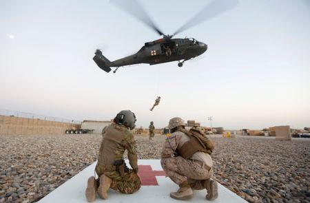 A U.S. Navy Corpsman and U.S. soldier take part in a helicopter Medevac exercise in Helmand province, Afghanistan