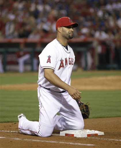 Los Angeles Angels' Albert Pujols watches after missing a ball during the seventh inning of a baseball game against the Los Angeles Dodgers in Anaheim, Calif., Thursday, May 30, 2013. (AP Photo/Jae C. Hong)