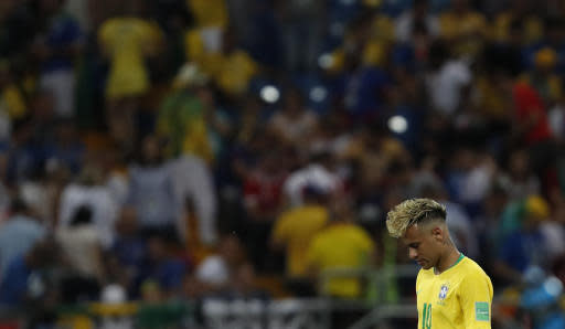 Brazil's Neymar looks down during the group E match between Brazil and Switzerland at the 2018 soccer World Cup in the Rostov Arena in Rostov-on-Don, Russia, Sunday, June 17, 2018. (AP Photo/Darko Vojinovic)