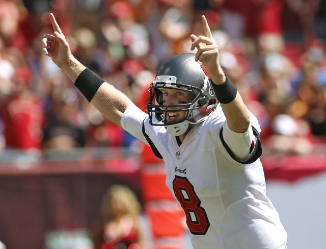 Tampa Bay Buccaneers quarterback Mike Glennon celebrates after throwing a touchdown pass to wide receiver Mike Williams during the first quarter of an NFL football game against the Arizona Cardinals Sunday, Sept. 29, 2013, in Tampa, Fla. (AP Photo/Reinhold Matay)