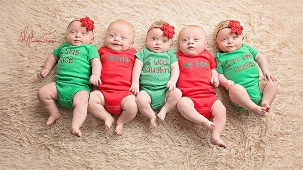 The Driskell quintuplets - Zoey, Asher, Dakota, Gavin and Hollyn, left to right pose in Christmas outfits. (Sweetlilpics by Ashley)