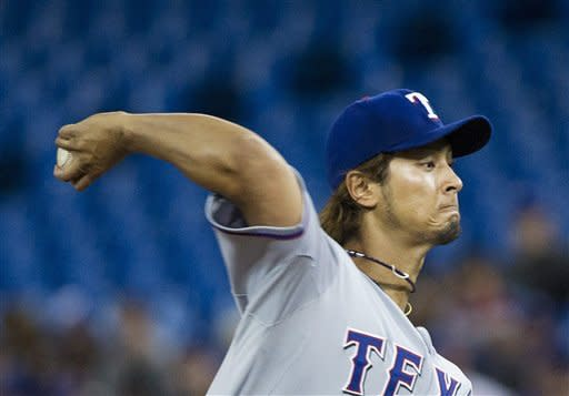 Texas Rangers starting pitcher Yu Darvish throws to the Toronto Blue Jays during the second inning of a baseball game in Toronto on Monday, April 30, 2012. (AP Photo/The Canadian Press, Nathan Denette)