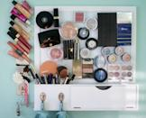 """<p>Glue magnets to your favorite palettes and stick them up on a magnetic board, like Margaret did at <a href=""""http://www.janickiphotography.com/2012/03/fridays-favs-magnetic-makeup-board/"""" rel=""""nofollow noopener"""" target=""""_blank"""" data-ylk=""""slk:Janicki Photography"""" class=""""link rapid-noclick-resp"""">Janicki Photography</a>. This way, your countertop remains clear, but your makeup is still within easy reach.</p>"""