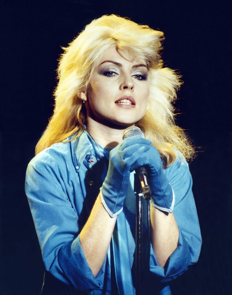 """<p>Bringing punky hairstyles into the mainstream, Blondie singer Debbie Harry rocked a <a href=""""http://www.goodhousekeeping.com/beauty/hair/news/g2443/blonde-hair-color-ideas/"""" rel=""""nofollow noopener"""" target=""""_blank"""" data-ylk=""""slk:shaggy, bleached look"""" class=""""link rapid-noclick-resp"""">shaggy, bleached look</a>.</p>"""