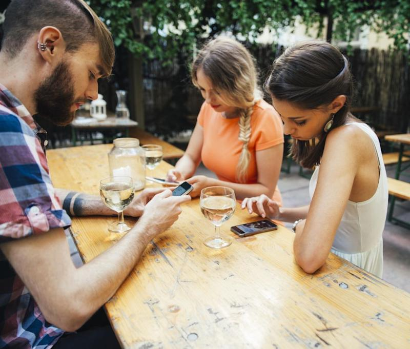 Sidebarring are the 'secret' conversations we all have on our phones. Photo: Getty