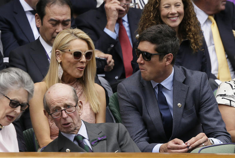 TV presenters Tess Daly and her husband Vernon Kay, from left, take their seats in the Royal Box on Center Court during day three of the Wimbledon Tennis Championships in London, Wednesday, July 3, 2019. (AP Photo/Tim Ireland)