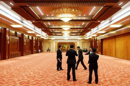 Delegates stand in a corridor of the Great Hall of the People on the second day of the 19th National Congress of the Communist Party of China in Beijing, October 19, 2017. REUTERS/Thomas Peter