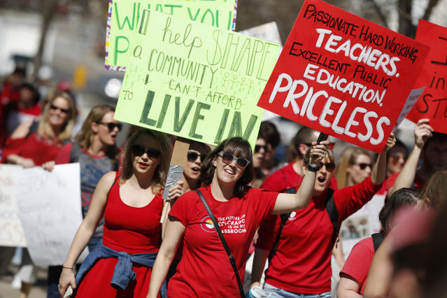 <p>Teachers march during a rally, Friday, April 27, 2018, in Denver. Colo. (Photo: David Zalubowski/AP) </p>
